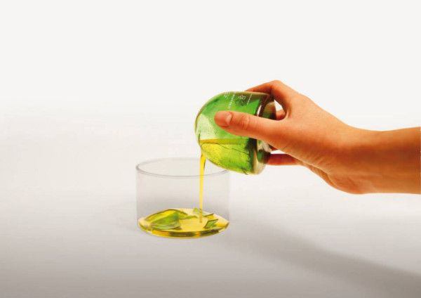 Oil package A package made of caramelized sugar, coated with wax. To open it you crack it like an egg. When the material is cracked the wax no longer protects the sugar and the package melts when it comes in contact with water. This package is made for oil-based products.