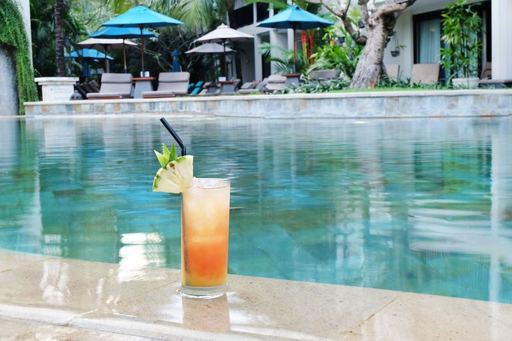 Enjoy Bali the right way—by the poolside while sipping on a delish cocktail! 🍸☀🌊   #TheCamakilaLegianBali #camakilabali #camakila #legian #bali