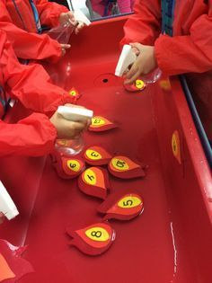 """Sensory fun with fire safety theme: we made little flames out of fun foam and wrote numbers on them. Add a little water to your sensory table so they float and give the children a spray bottle with water in it. The children can squirt the """" flame"""" the number of times the number says, or squirt them in numerical order."""