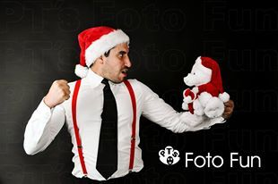 Sweet or tough? Christmassy man with teddy bear