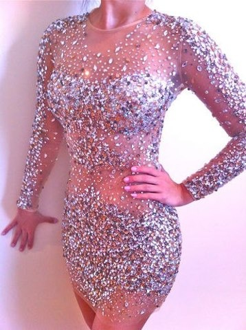 This dress reminds me of the bedazzled body suit Britney Spears wore in her Toxic music video. I want!