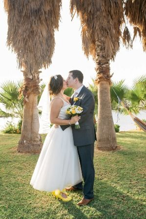 Bride & groom under the palm trees after their private exotic palm bay wedding in Crete. Moments