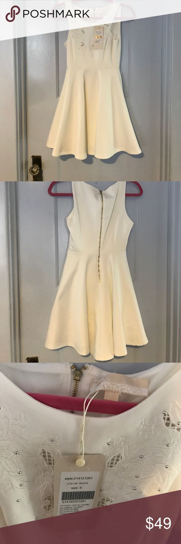 White Dress with Beaded Detail Super cute white dress with beaded detail on front!   NEVER BEEN WORN WITH TAGS ATTACHED   Not sure where we bought it from!!   Size SMALL   Open to offers :) Nordstrom Dresses