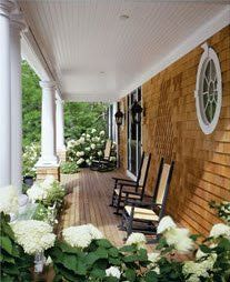 LOVE this cedar shake porch and the huge white hydrangea .