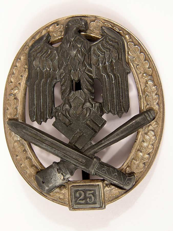 """Army / Waffen SS General Assault Badge for 25 engagements by JFS. This excellent example displays excellent frosting on the wreath. The darkened Wehrmacht eagle above the bayonet and grenade retain most of their gray finish. The reverse features the standard crimped hinge and recessed """"C"""" catch. The JFS is incused on the right side of the wreath."""