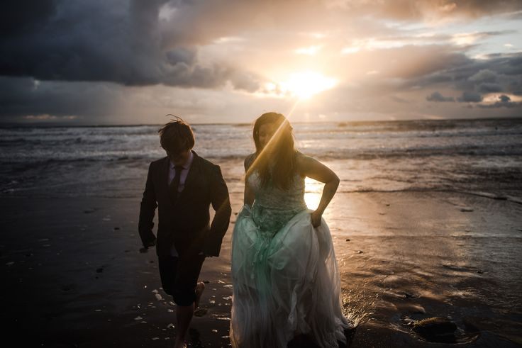 A wedding at Ash Barton Lodge.   A 'trash the dress' beach session with holy powder at sunset. By Angela Ward Brown