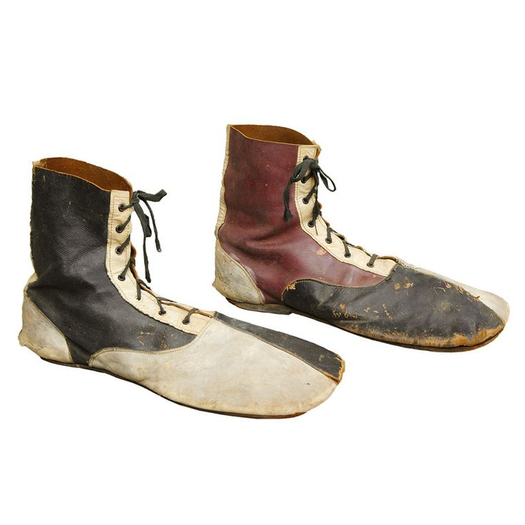 c. 1900 Clown Shoes  American  c. 1900  Fantastic early pair of clown shoes in black, white, and burgundy leather.