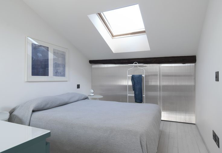 Sleeping room on the top level. Duplex apartment in the centre of Milan by +R / www.piuerre.com / photo by Michele Filippi / #apartment #renovation #interior #duplex #bedroom #attic #renovation #velux #polycharbonate #translucent #natural #lighting #wood
