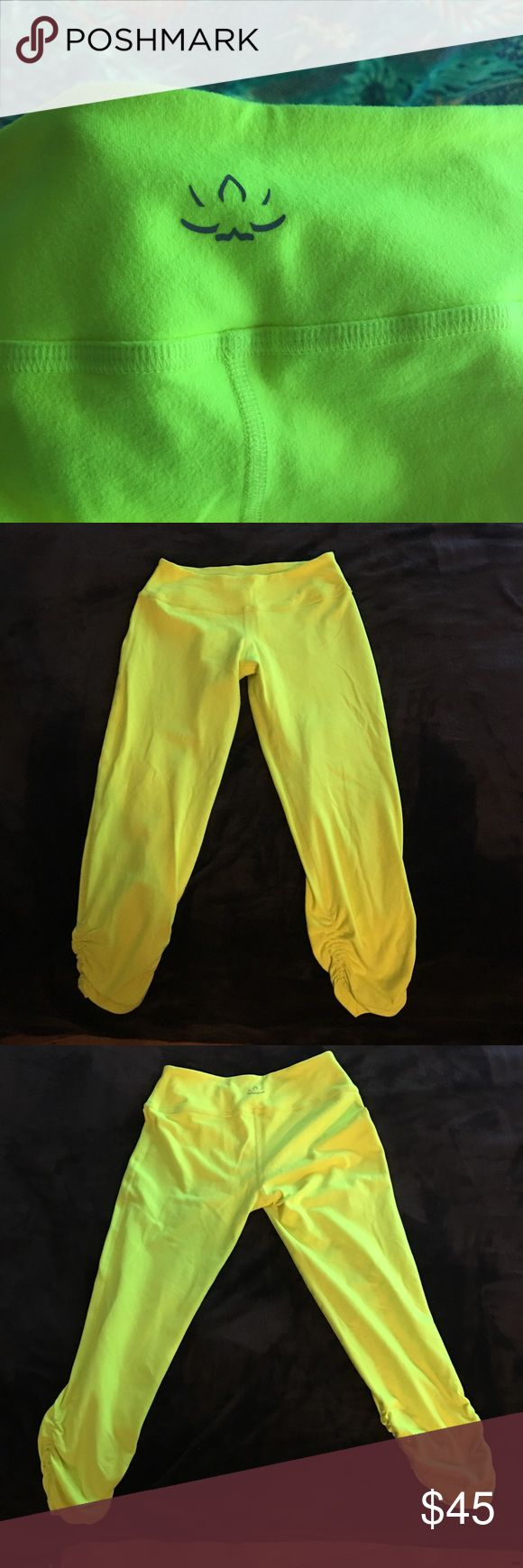 Beyond Yoga Gathered Capris Legging Neon Yellow These leggings have been worn once or twice and are in overall really good condition. They are the softest material and very flattering. The cover photo is the best representation of the actual color. Beyond Yoga Pants Capris
