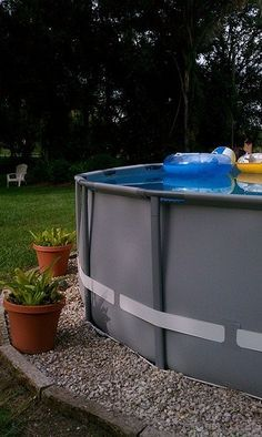 landscaping around above ground pools | Landscaping around base of Intex Ultra Frame pools  Above Ground ...
