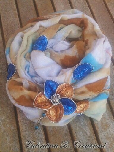 Scarf with Nespresso flower brooch