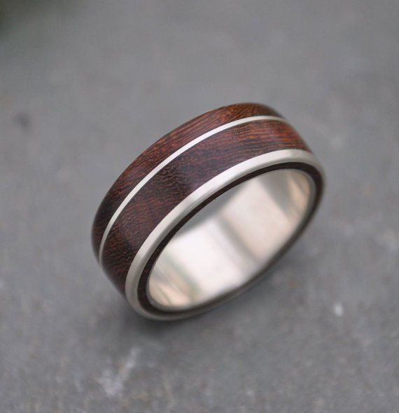 Un Lado Asi Wood Ring wood and silver wedding by naturalezanica (via The.Minted.Dad)