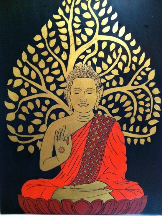 Buddha with hand in teaching mudra