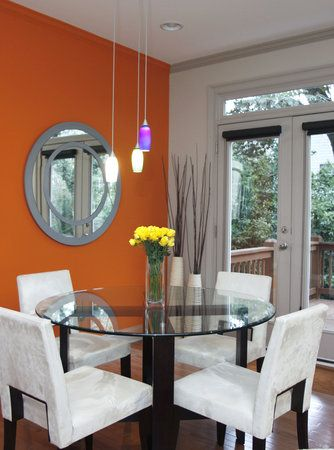 modern tone down bright orange dining room walls with white and dark woods
