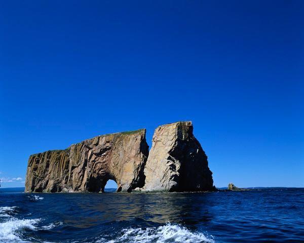 Perce Rock rises from the ocean along Canada's coastline.