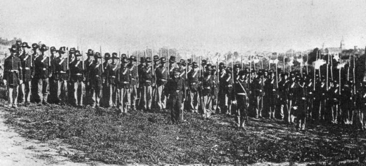 """Image of Company I of the 7th Wisconsin taken in 1862 in Virginia. The 7th was part of the famous """"Iron Brigade,"""" or as the Confederates called them """"That damn Black Hat Brigade"""" in reference to the black Hardee hats that they wore. While the all western brigade would fight throughout the entire war, their original membership was devastated at the Battle of Gettysburg and never quite recovered."""