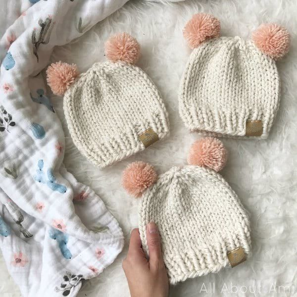 Knit a simple baby beanie with a beautiful wool blend yarn and pom poms for added cuteness!