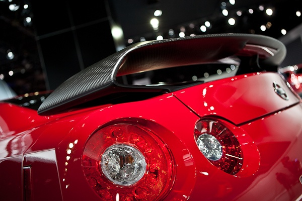 The 2013 Nissan GT-R's new dry carbon rear spoiler is designed to be as slippery to the wind as it is attractive to the eyes.