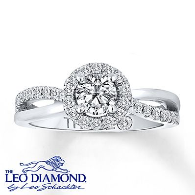 This engagement ring features stunning Leo Diamonds forming a hypnotic center and decorating the split-style band in brilliance. The 14K white gold ring for her has a total diamond weight of 7/8 carat. The Leo Diamond® is independently certified and laser-inscribed with a unique Gemscribe® serial number. Diamond Total Carat Weight may range from .83 - .94 carats.