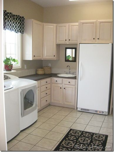 I love this idea of having a whole utility room with your spare fridge and sink, etc with your laundry!