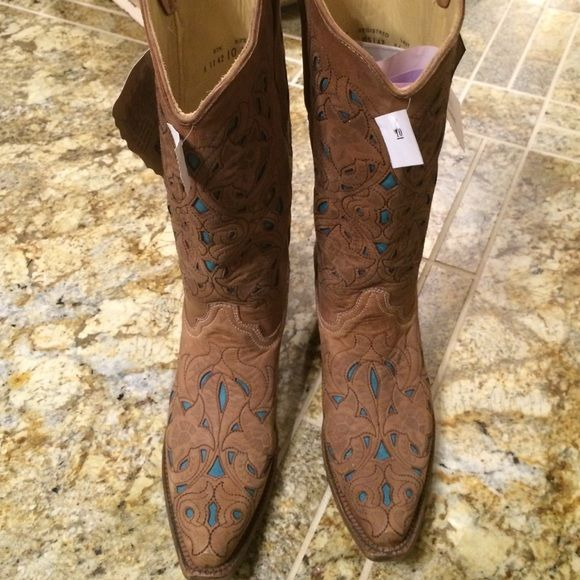 Brand new Corral western laser cut boot Authentic Corral laser cut all leather western boot. Beautiful light  brown color with laser cut design with turquoise leather showing through the cutouts. Leather bottom with rubber inset at ball of feet for extra comfort! Purchased at one of the finest boot stores in Arizona 2 years ago and never worn. Tags still all in tact   Absolutely stunning, wish they were my size!! Corral Shoes