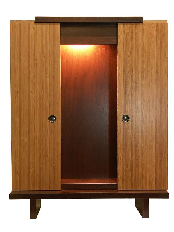 This modern butsudan is constructed of cherry wood with bamboo ply doors that slide open. The dark stain accentuates the beautiful bamboo texture. It's sleek and compact design make it an excellent starter butsudan. Does not accommodate the larger Okatagi Gohonzon.