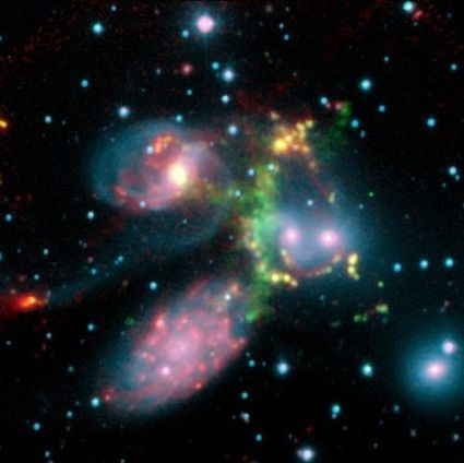 Quintet of Galaxies Rocked by Shock Wave Larger than the Milky Way