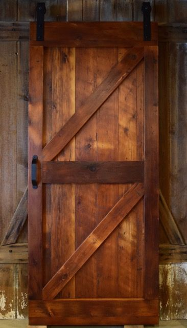 Barn door made entirely out of reclaimed barn wood by www.FurnitureFromTheBarn.com