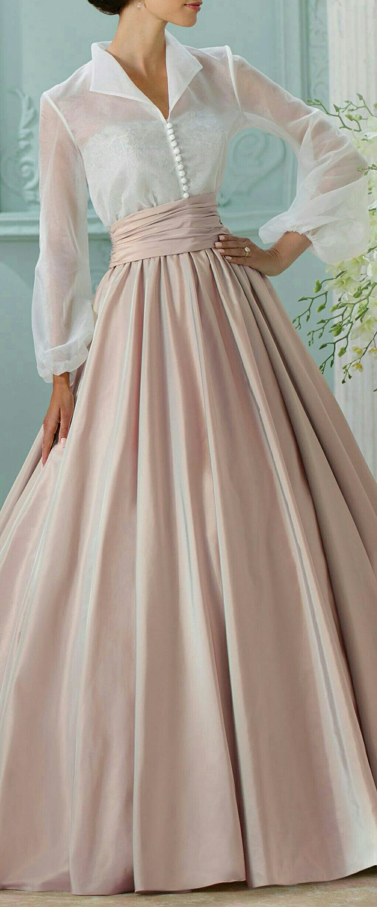 Reminds me of Anna from the King and I, a big hoop skirt - love it