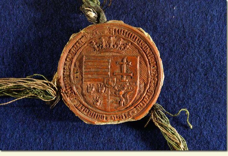 Mátyás viaszpecsétje 1458-ból Magyarország, Csehország és Dalmácia egyesített címerével. MTAK, K 322/413