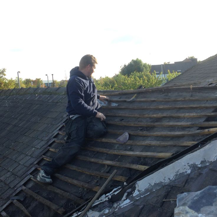 Mat roofer extrodinare from Jump Energy working with the original Welsh slate tiles.  It's good stuff - we know because modern tile cutters don't touch it.  He has had to dig out the original roofers pick to help work with this great material