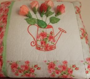 Or you can make the pillow with a watering can holding 3D machine embroidered rose buds.