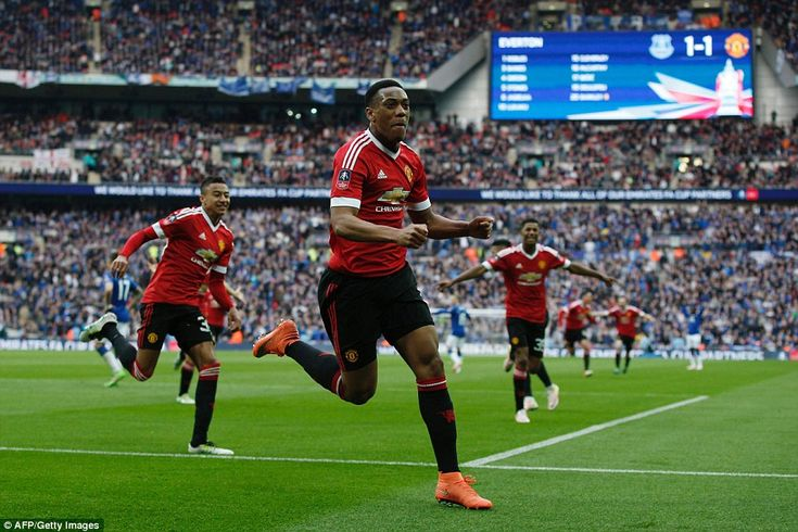 Anthony Martial celebrates after scoring an injury-time winner to send Manchester United into the FA Cup final over Everton