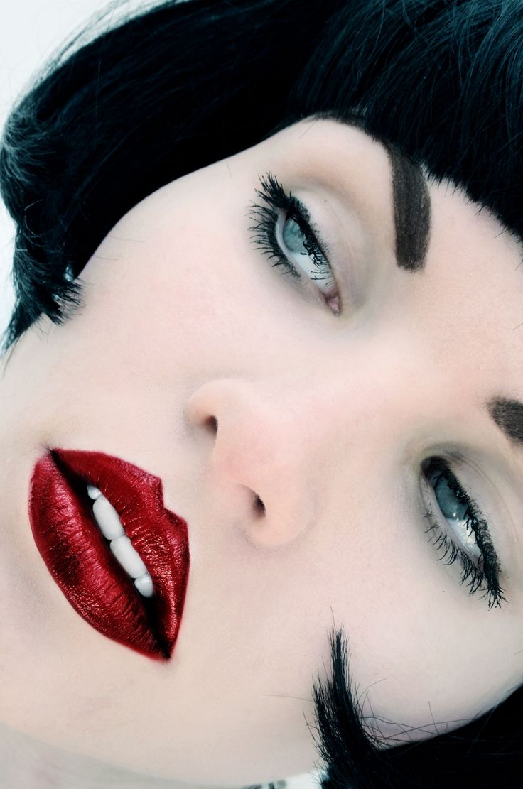 color contrast: deep red lips on white white skin with silver blue eyes: Alexija by Stanley Patzold
