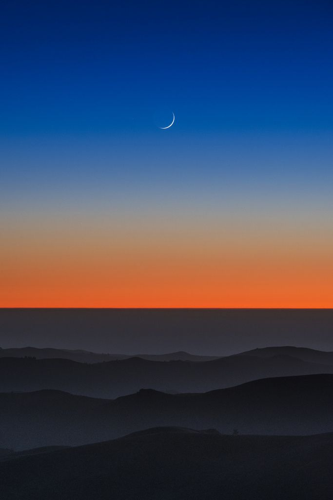 ~~waxing crescent | la honda, california | magical orange to blue sunset completed by a crescent moon | by elmfoto~~