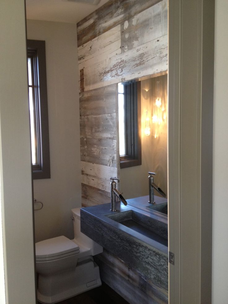 White grey barn board siding gives this powder room a for Gray rustic bathroom
