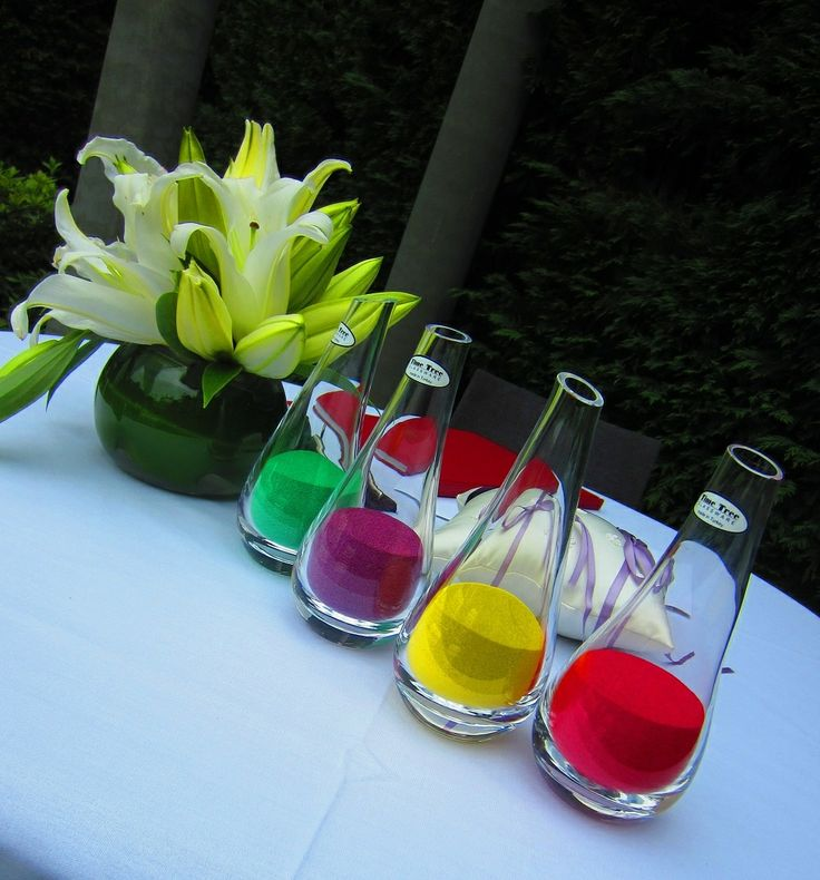 Stunning crystal colored sand vials await the pouring ritual at Quat Quatta