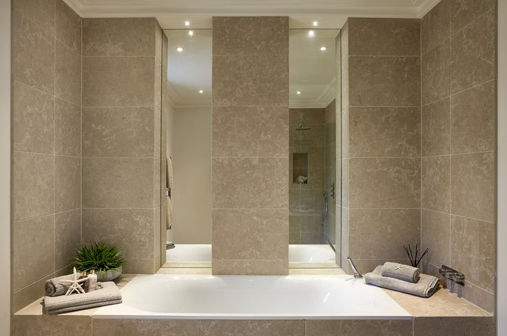 Family bathroom with neutral wall and floor tiling
