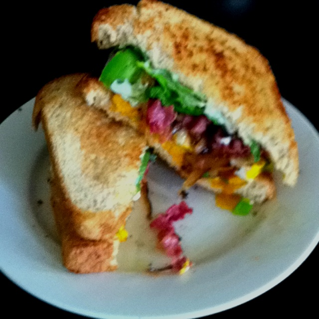 Gourmet egg sandwich: egg fried in green bell pepper with caramelized ...