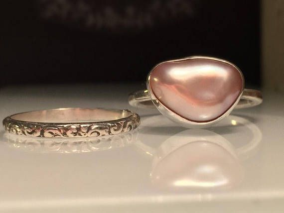 Modern Pearl Ring. Unique Pearl Ring. Blush Pearl Ring. Solitare Pearl Ring. Trillion Pearl Ring. Pink Pearl Ring. Modern Pearl Ring. Beautifully Handcrafted upcycled bezel set Natural Cultured Pearl set on a lightly hammered solid sterling silver band.. This unique yet very versatile ring