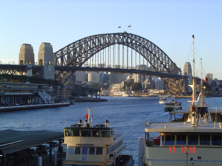 Sydney Harbour Bridge looking towards Milsons Point and Luna Park. Circular Quay and Ferries in the foreground.