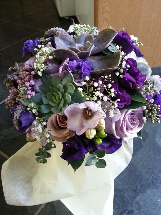 My bouquet. Purple and lilac roses, lisianthus, freesias succulents. Created by Green Room flowers.