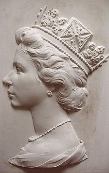 Plaster cast of HM Queen Elizabeth II by Arnold Machin used to create the effigy of the Queen's head as it appears on stamps. This rare cast was found in the cupboard of the artist's home