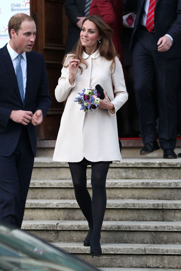 Pregnant Kate Middleton wrapped up her baby bump in a gorgeous cream coat for a royal engagement with Prince William.