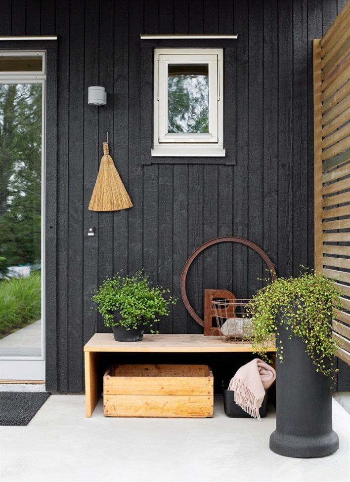 Black house, natural textures, entry