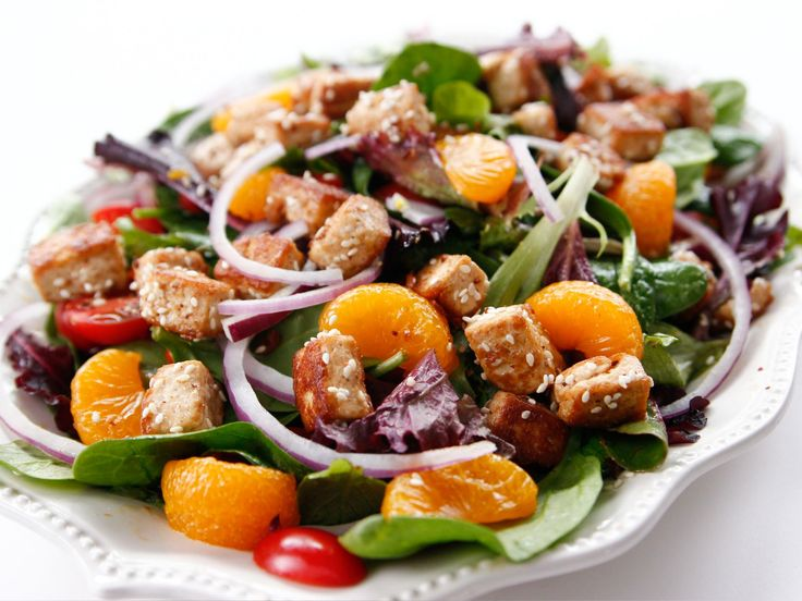 Sesame Tofu Salad recipe from Ree Drummond via Food Network, pioneer woman, the tofu is marinated in sesame oil, olive oil, soy sauce, ginger and garlic, some honey, rice wine vinegar, and I think that's it
