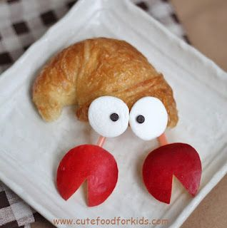 Cute Food For Kids?: Crescent Roll Hermit Crab  (all you need are marshmellows carrots choclate chips and crescent rolls!!!)