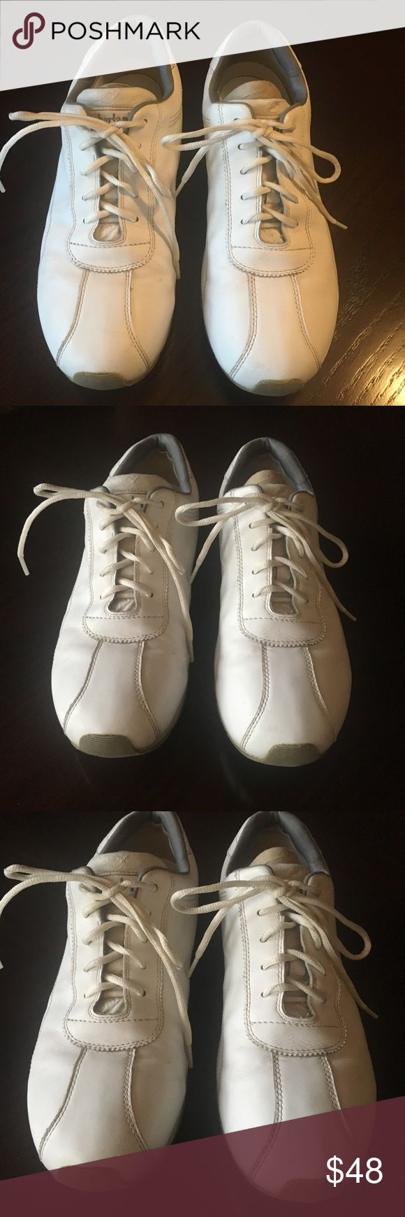 Timberland Sneakers White Timberland sneakers in great used condition! Gray logo with some additional gray detailing. Super comfortable insole makes them easy to wear all day. Genuine leather upper. Size 10 1/2 Timberland Shoes