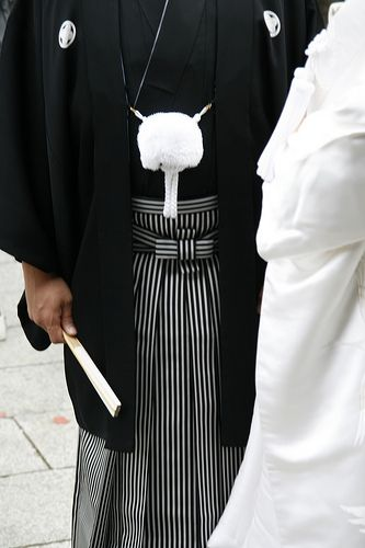 This bride and groom are doing a black tie wedding, sort of. This is a very formal Japanese wedding look!