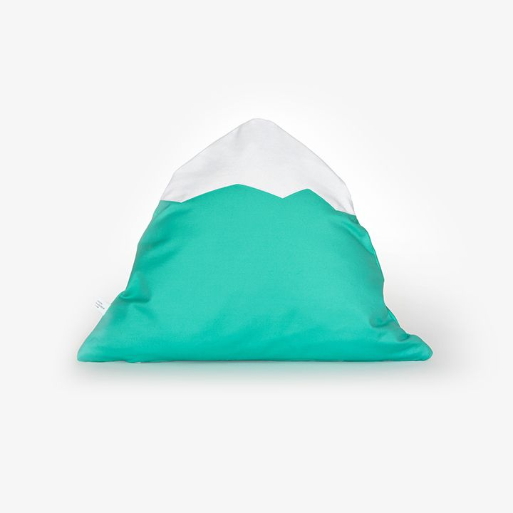 The iconic whimsical mountain pillow is named after Herdubreid — the queen of Icelandic mountains. This is the mint green edition